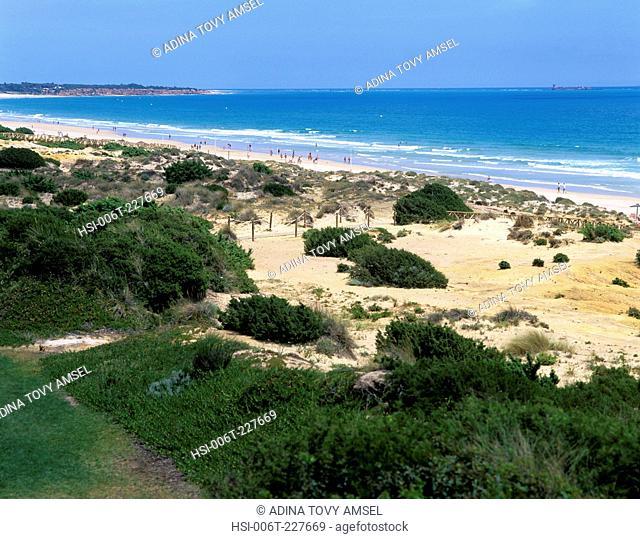 Spain. Luz. Costa De La Luz. Playa La Barrosa. View of sand dunes and beach
