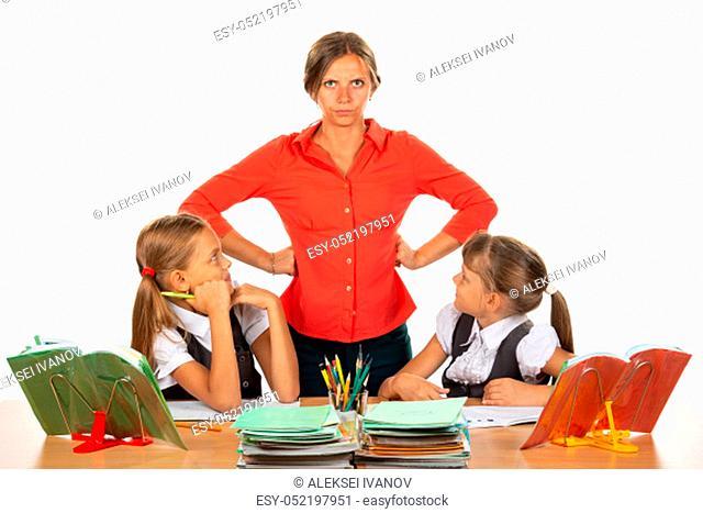 Children look at an evil teacher