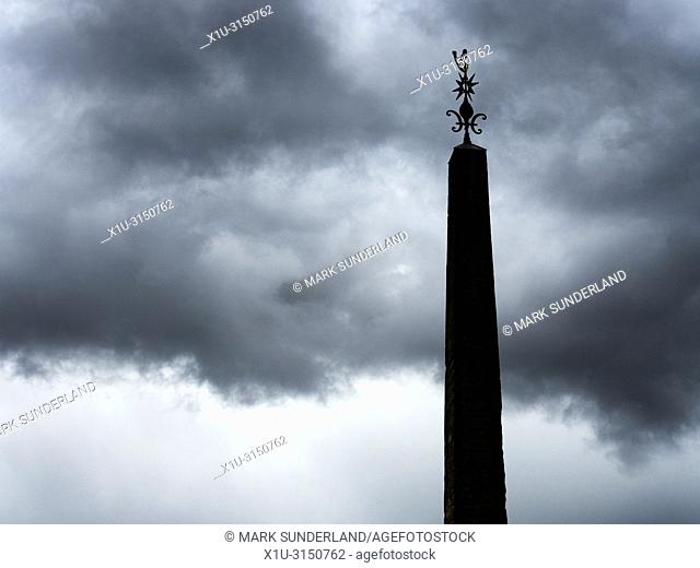 Summer storm clouds hathering over The Obelisk in the Market Place at Ripon Yorkshire England