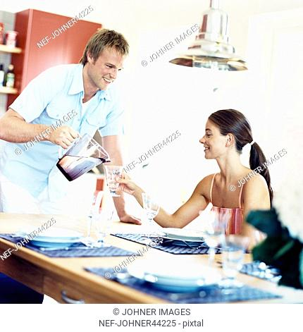 Man and woman at the dining table