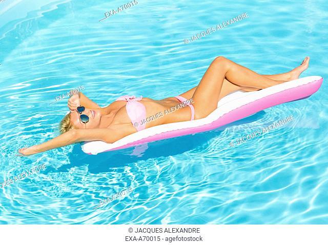 cheerful woman in swimming pool