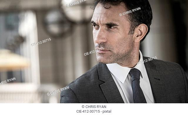 Close up pensive corporate businessman looking away
