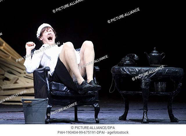 "03 April 2019, Saxony, Dresden: The actress Nadja Stübiger sits on stage during a photo rehearsal for the play """"Eine Straße in Moskau"""" at the Staatsschauspiel..."