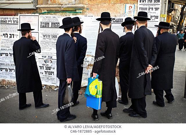 Jerusalem, Israel, Yeshivah, Mea Shearim quarter, Orthodox Jews reading advertisements