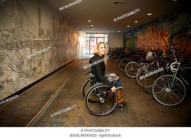Paraplegic woman sitting in wheelchair