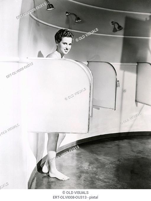 Woman showering in big shower room (OLVI008-OU313-F)