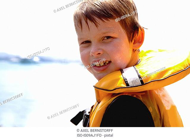 Close up portrait of smiling boy in lifejacket