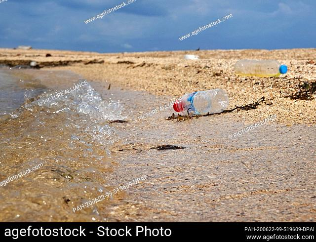 27 October 2019, Thailand, Ko Mak: Empty plastic drink bottles lie on the beach. The island is about 16 square kilometers large and is located in the eastern...
