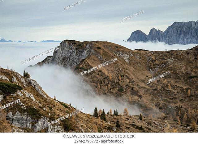 Misty autumn day in Carnic Alps near Sappada, Dolomites, Italy