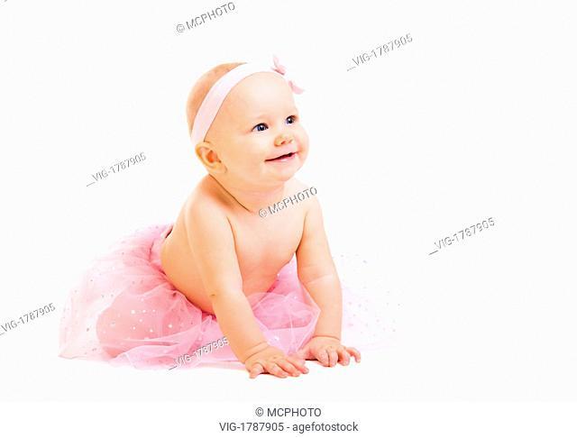 Baby Ballerina. Very cute happy baby girl wearing ballerina skirt. Isolated on white. - 01/01/2009