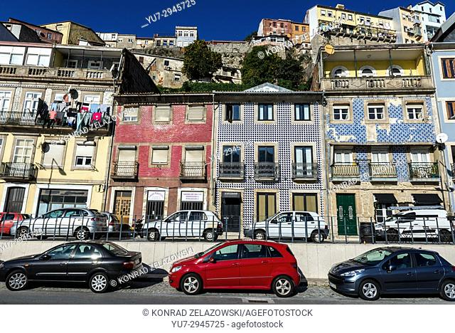 Buildings and cars on Rua da Ribeira Negra street in Porto city on Iberian Peninsula, second largest city in Portugal