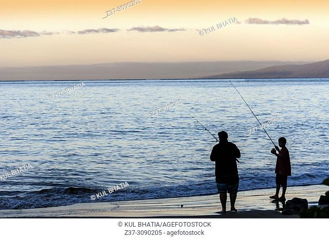 Fishing at the Charley Young beach in early morning. Two fishermen cast their lines from the shore