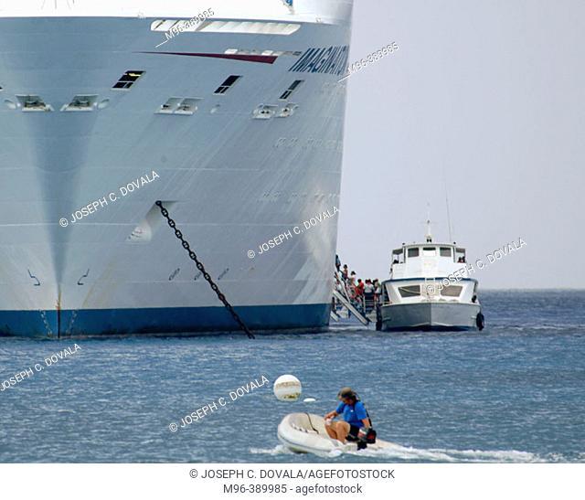 Passengers board cruise ship by shoreboat