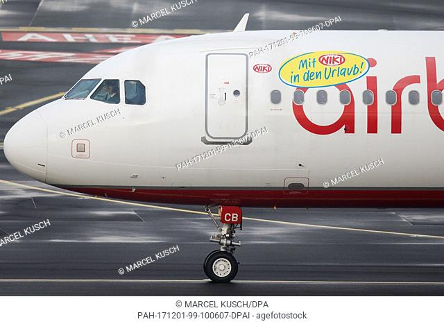 A plane of the bankrupt airline Air Berlin with a sticker of Niki airline rolls along the runway at the airport in Duesseldorf, Germany, 1 December 2017