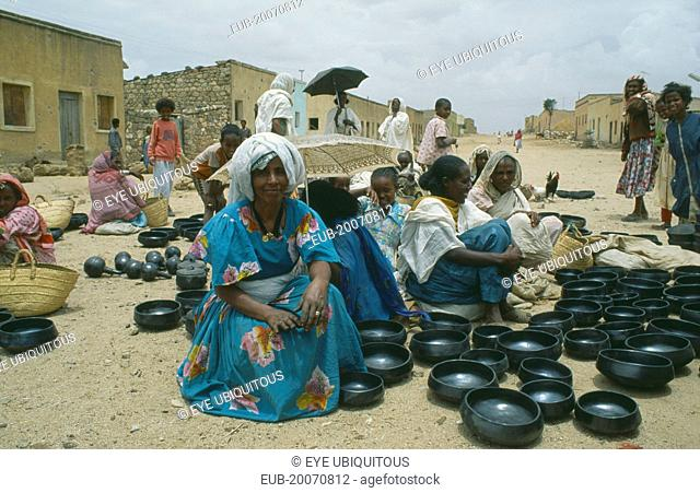 Women selling black pottery at market