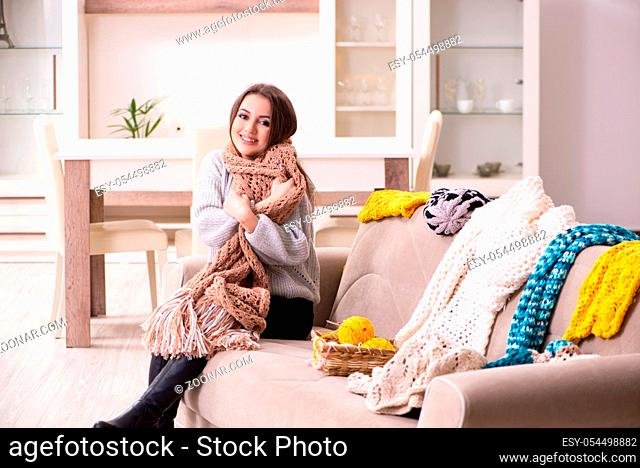 The young beautiful woman knitting at home
