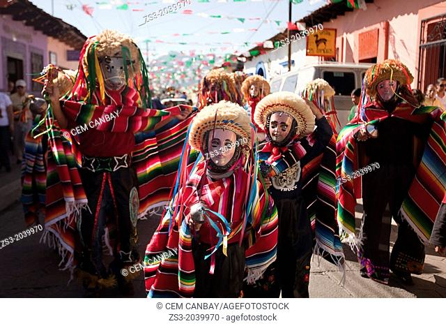 Traditionally dressed mayan people wearing masks in the celebration of the feast day Our Lady of Guadalupe which is the patron saint of Americas