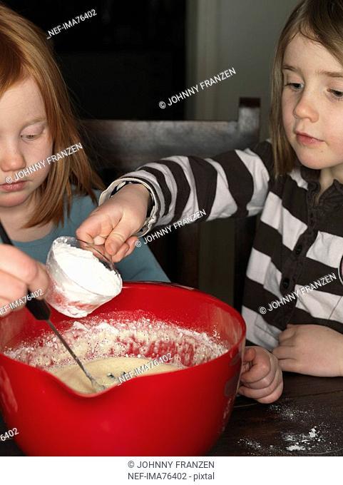 Two girls baking, Sweden