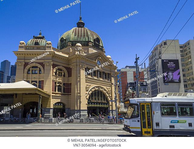 City tram passing Flinders Street Station on Swanston Street, Melbourne, Victoria, Australia