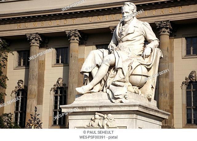 Germany, Berlin, Wilhelm von Humboldt, Statue of Thomas Humboldt with Humboldt University in background