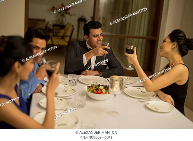 Four friends at formal dining table