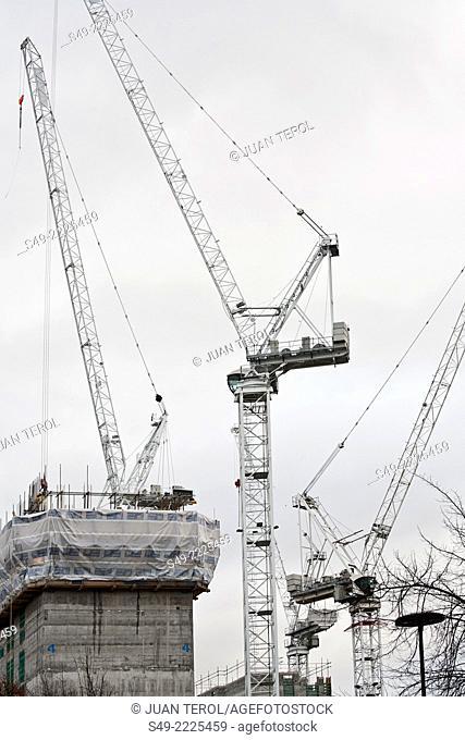 Several cranes on a construction site in Southwark, London Bridge, London, England, UK