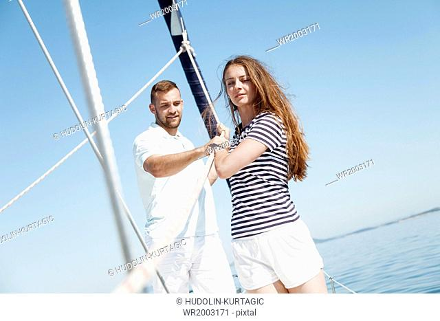 Young couple on sailboat, Adriatic Sea
