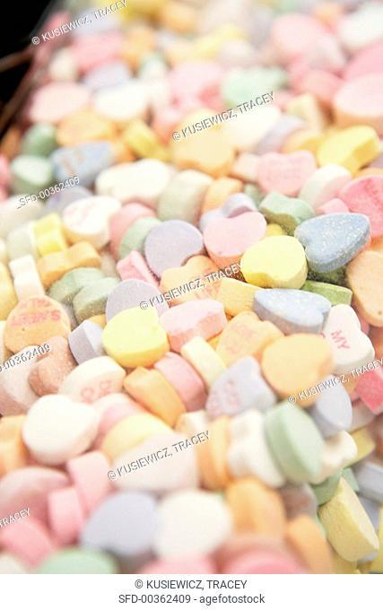 Mixed sugar hearts in a sweet dispenser