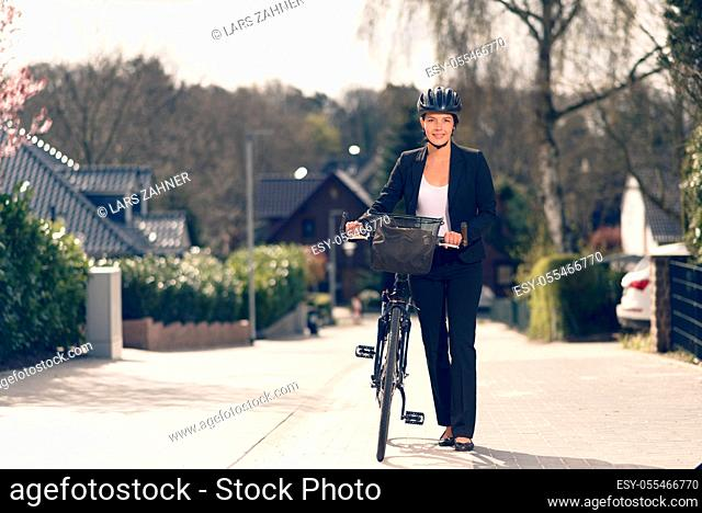 business woman, cycling, cyclist, commuter