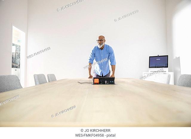 Confident businessman in conference room preparing a presentation