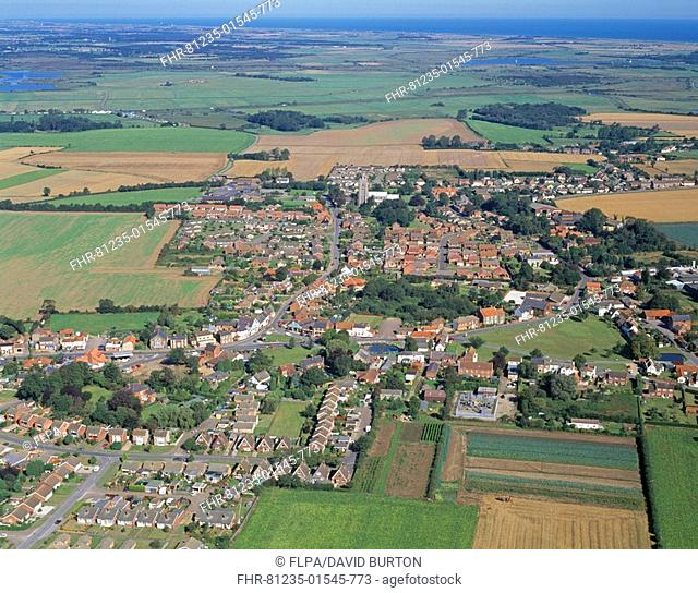 Aerial view of coastal village, with housing estates, pond and green, Martham Village, The Broads N P , Norfolk, England