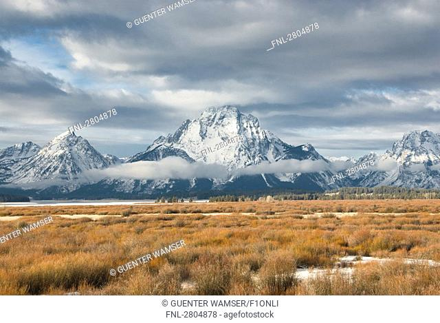 Storm clouds over snowcapped mountains, Grand Teton, Grand Teton National Park, Wyoming, USA