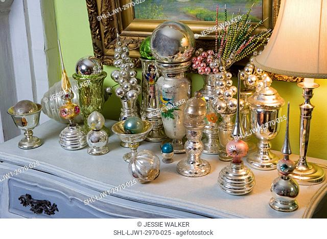 COLLECTION DISPLAY: Mercury glass vases, Christmas ornaments, treetoppers, beaded picks, on table top