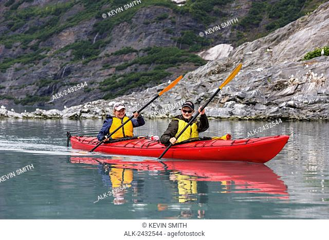 Mother and teen son sea kayaking in Shoup Bay State Marine Park, Prince William Sound, Southcentral Alaska