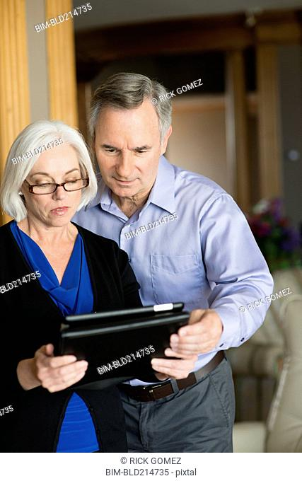 Caucasian couple using digital tablet