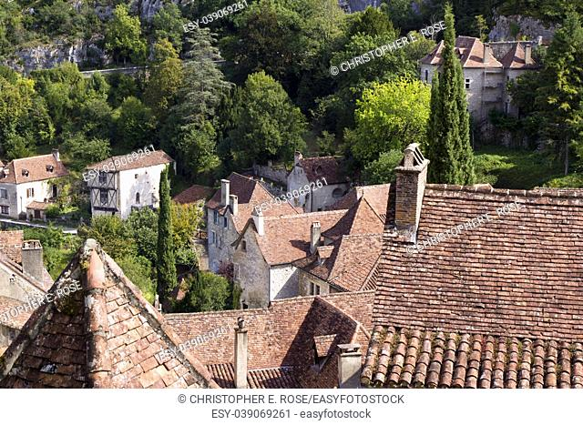 View over the rustic tiled rooftops of the picturesque clifftop tourist attraction village of St Cirq Lapopie, Lot, France, Europe