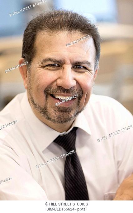 Close up of Hispanic businessman smiling