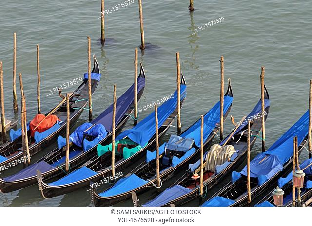 Row of empty moored gondolas, elevated view from the Campanile, Venice, Italy