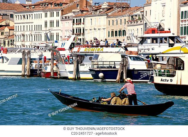 Gondola and gondolier, Palaces facades, boats and vaporetto, Canal Grande, Venice, Venetia, Italy