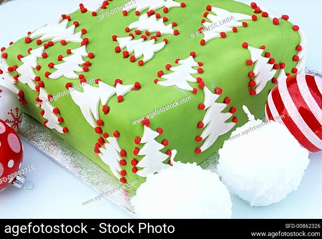 Christmas cake decorated with fir trees