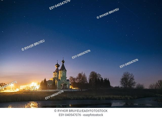 Old Russian Wooden Orthodox Church Of The Holy Trinity Under Night Starry Sky In Village Krupets, Dobrush District, Gomel Region, Belarus