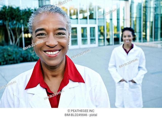 Portrait of smiling doctor outdoors at hospital