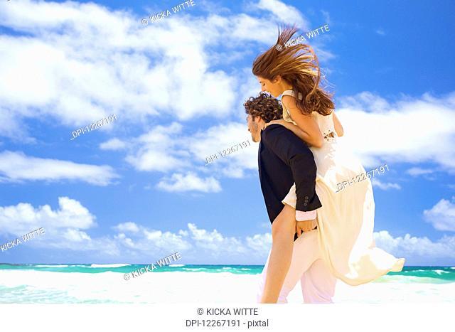 Couple on the beach; Kealia, Kauai, Hawaii, United States of America
