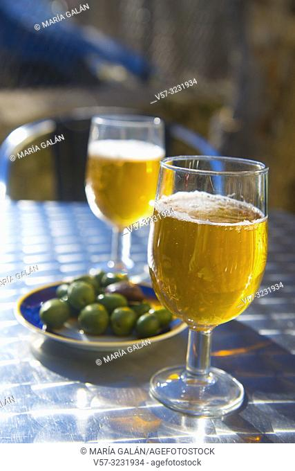 Two glasses of beer with olives in a terrace. Spain