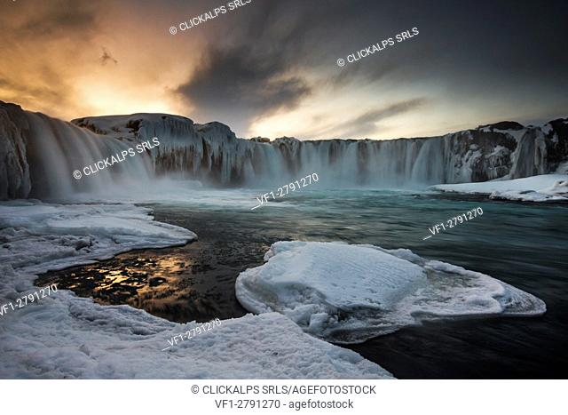 Gullfoss waterfall in northern Iceland at sunset in winter dress, as the falls are partly frozen