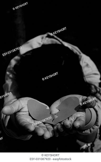 Femail Offer Broken Heart in Hands