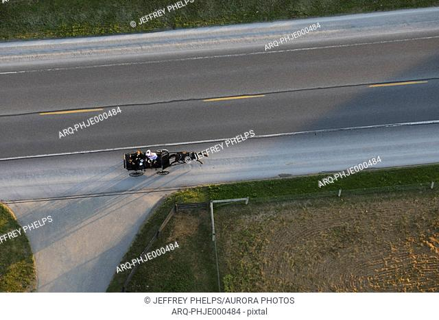 Aerial view of Amish carriage riding down road, Lancaster County, Pennsylvania, USA