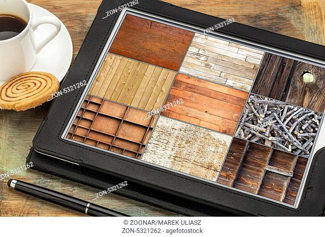 reviewing pictures of wood texture on a digital tablet computer with stylus pen, coffee cup and cookie