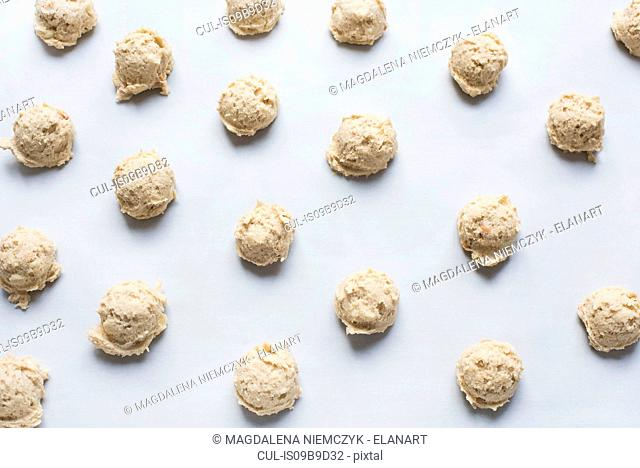 Balls of raw cookie dough on baking sheet, close-up