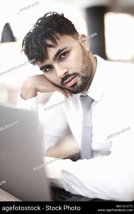 Businessman in cafe with laptop